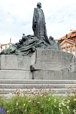 The large monument in the middle of the Old Town Square in Prague is the statue of the reformer Jan Hus.
